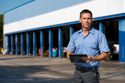 Auto Mechanic with Clipboard at Work
